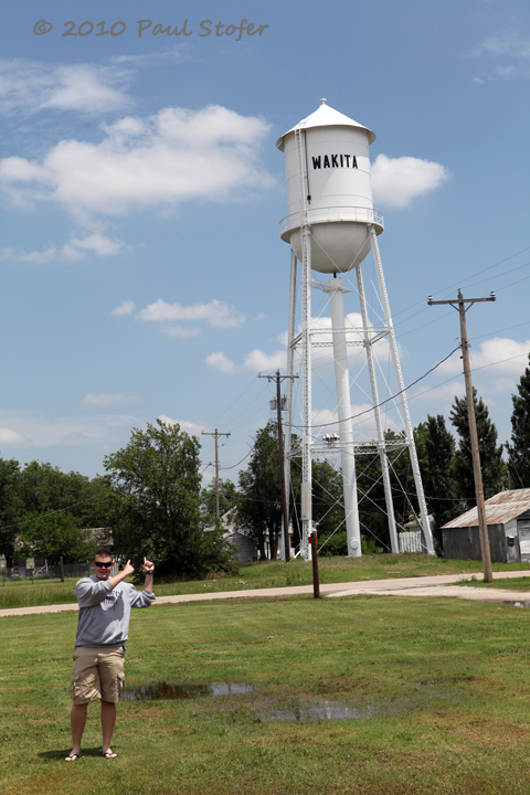 Posing in front of the Wakita, Kansas water tower