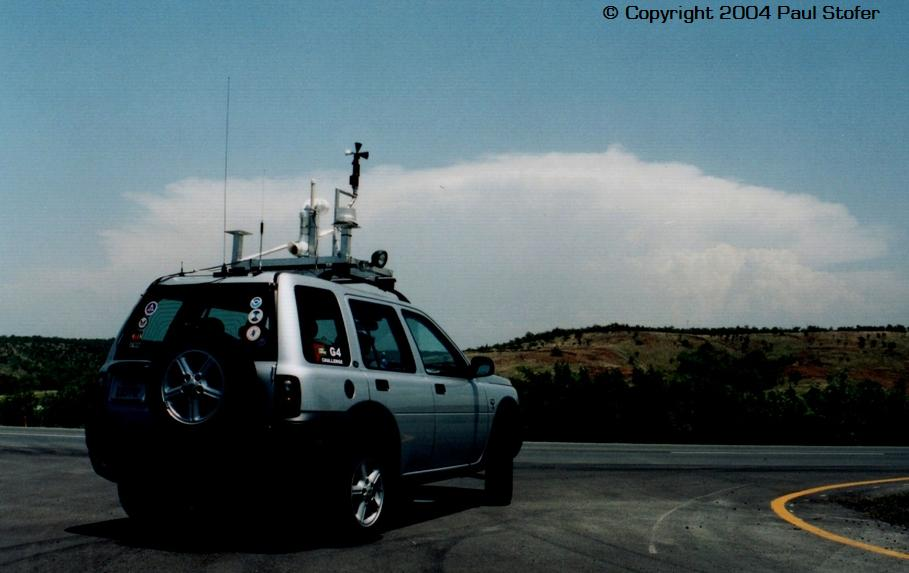 My vehicle infront of a tornaic supercell