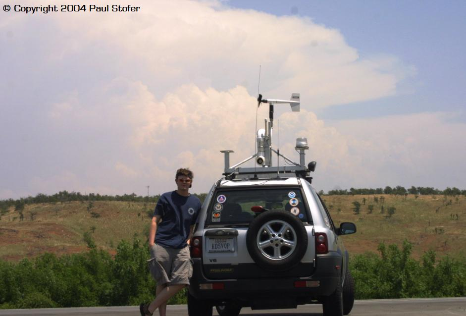 My vehicle and I with a tornadic supercell in the background